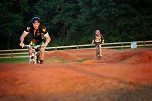 The Sokol Park Pump Track, a series of red dirt hills, is designed so that the biker can bounce along the hills without having to pedal.